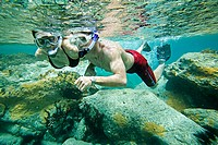Couple snorkeling on Colombier Beach, St. Barts