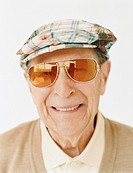 Smiling Senior Man Wearing Sunglasses and a Flat Cap