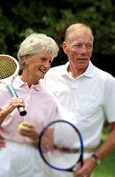 Senior couple with tennis gear