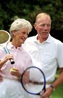 Senior couple with tennis gear