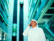 Arab businessman using cell phone