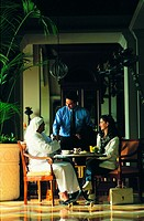 Meeting of Arab businesspeople in a cafe (thumbnail)