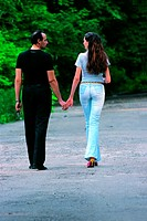 Couple holding hands in a park (thumbnail)