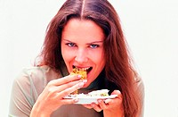 Woman eating a piece of cake (thumbnail)
