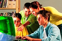 Group of pupils and mother at computer