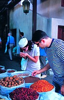 Western tourists smelling exotic spices on the spice market in Dubai, United Arab Emirates