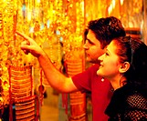 Tourists looking at jewellery in the Gold Souq in Dubai, United Arab Emirates