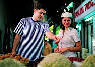 Western couple on the spice souq in Dubai, United Arab Emirates