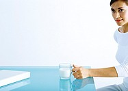 Woman sitting with glass of milk