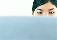 Woman looking over edge of screen, looking at camera