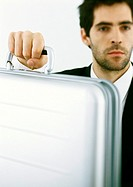 Man with stubble holding briefcase