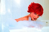 Woman with red hair having a bath