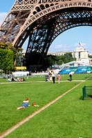 Woman reading under the Eiffel Tower in Paris