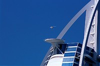 A helicopter landing on top of Burj Al Arab Hotel in Dubai, United Arab Emirates