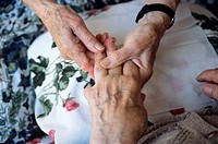 Patient recieving a hand massage at St Michael´s Hospice, St Leonards-on-Sea, UK.