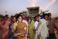Crowd of construction workers in Bangalore, India. They are working on new office buildings for technology companies.
