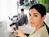 Portrait of a Young Businesswoman Texting on a Mobile Phone