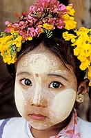 Myanmar (Burma). Mandalay Province. Pagan or Bagan. Children with make up mask for protection