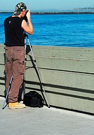 Photographer on the Ocean Beach Pearl. Ocean Beach, California, USA