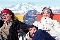 young couple, sunbathing on the snow
