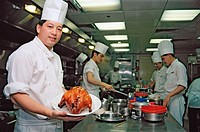 Cook with lacquered duck. Hong Kong, China