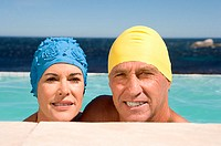 Mature couple in swimming caps