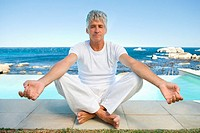 Mature man in yoga position