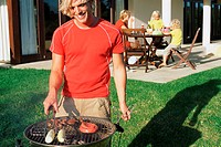 Man doing barbecue for his family