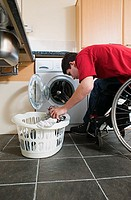 Disabled man doing laundry