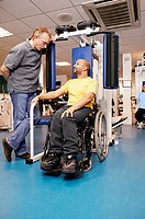 Disabled man using gymnasium