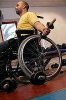 Disabled man lifting weights