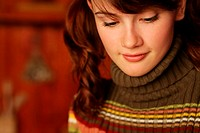 Young woman in roll neck sweater