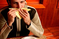 Man wiping his mouth with napkin
