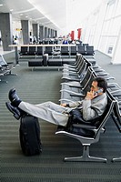 Businessman on cell phone at airport