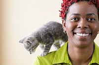 Portrait of woman with red hair and kitten