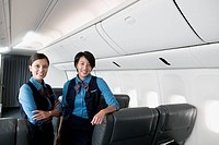Portrait of two female flight attendants