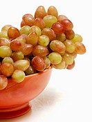 Red and Green Grapes in Red Bowl
