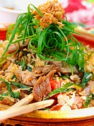 Nasi goreng with pork and spring onions
