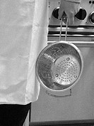 Person holding kitchen sieve