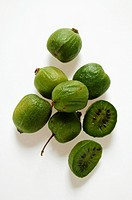 Mini-kiwi fruits, one halved