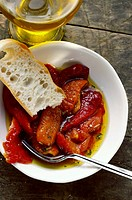 Marinated red peppers with olive oil and white bread