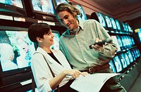 Young couple shopping for a television (thumbnail)