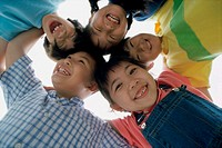 Low angle view of a group of children in a huddle