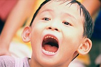 Close-up of a boy with his mouth open (thumbnail)