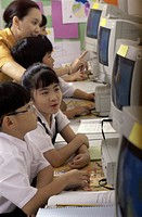 Children sitting in a computer lab