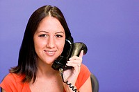 Close-up of a businesswoman talking on a telephone