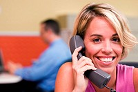 Portrait of a businesswoman sitting in an office talking on a telephone