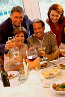 Group of people celebrating with glasses of wine