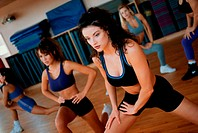 Group of young women exercising in an aerobics class