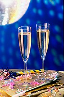 Close-up of two champagne flutes on a table (thumbnail)